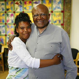Jeanine hugging Archbishop Desmond Tutu at Camphill Village